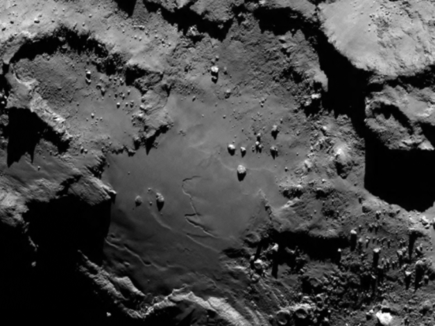Comet details Stunning close up detail focusing on a smooth region on the 'base' of the 'body' section of comet 67P/Churyumov-Gerasimenko. The image was taken by Rosetta's OSIRIS narrow-angle camera and downloaded today, 6 August. The image clearly shows a range of features, including boulders, craters and steep cliffs. The image was taken from a distance of 130 km and the image resolution is 2.4 metres per pixel.  Credits: ESA/Rosetta/MPS for OSIRIS Team MPS/UPD/LAM/IAA/SSO/INTA/UPM/DASP/IDA